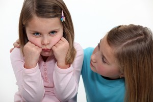 bigstock-A-little-girl-trying-to-cheer--32054174